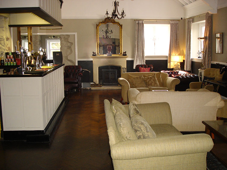 with comfy sofas and a wood burning stove for cooler evenings