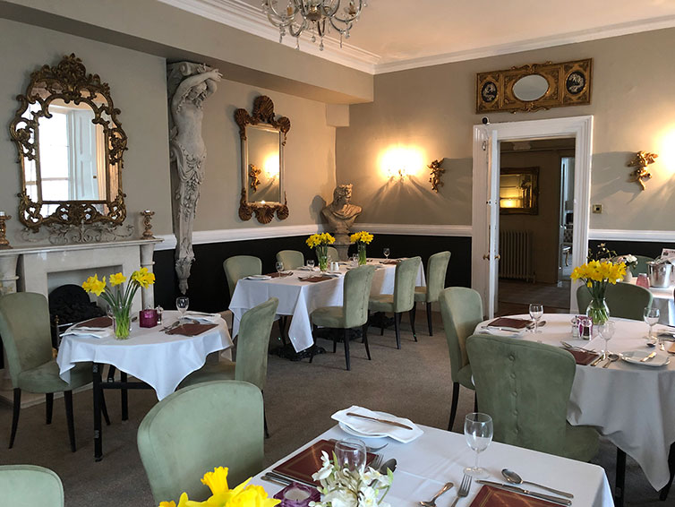 our intimate dining room with comfortable velvet dining chairs